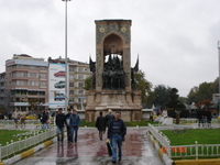 Monument of Independence at one end of Taksim Square (it was raining heavily that day)